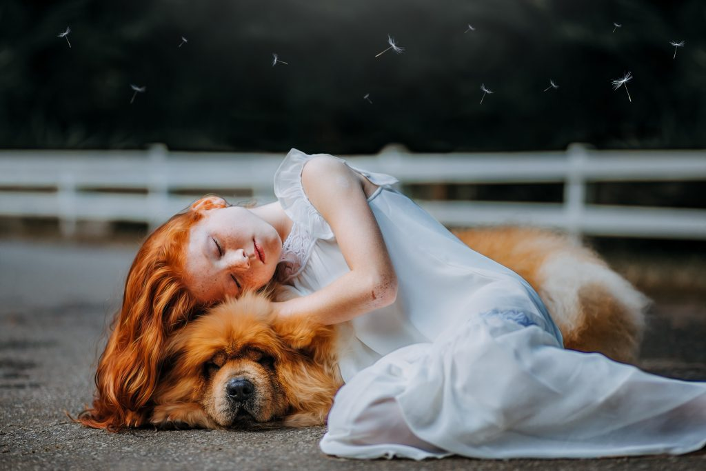 girl sleeping with a dog