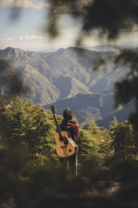 guitarplayer in the forest